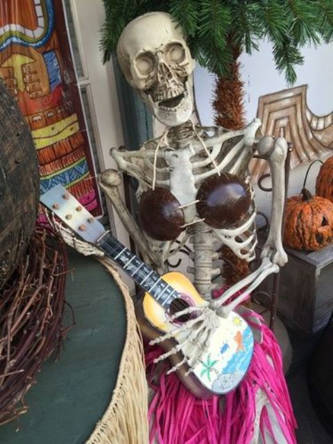 11-lady-skeleton-with-a-guitar-is-a-whimsy-Halloween-decor-idea