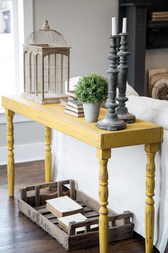 12-a-distressed-yellow-onsole-table-will-stand-out-in-a-grey-living-room