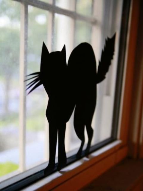 13-you-can-easily-make-and-attach-black-paper-silhouettes-to-windows