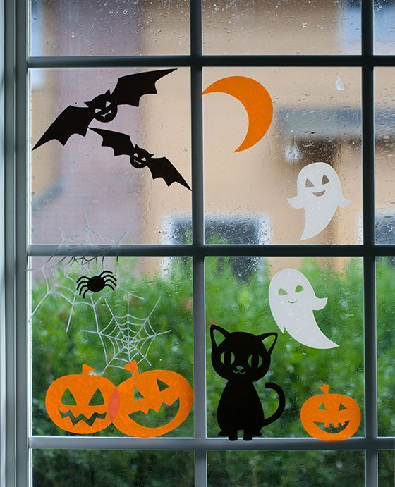 14-adorable-Halloween-window-clings-featuring-happy-pumpkins-laughing-ghosts-and-pretty-cats