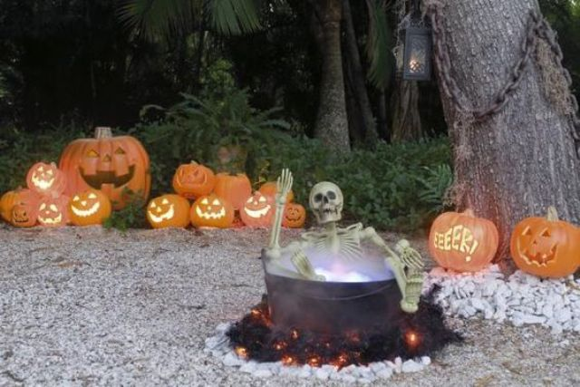 14-yard-haunt-with-a-skeleton-in-a-cauldron-and-jack-o-lanterns