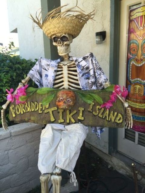 15-tropically-dressed-skeleton-with-a-sign
