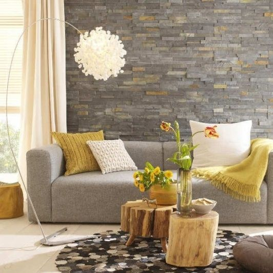17-grey-stone-accent-wall-a-dove-grey-sofa-and-yellow-textiles