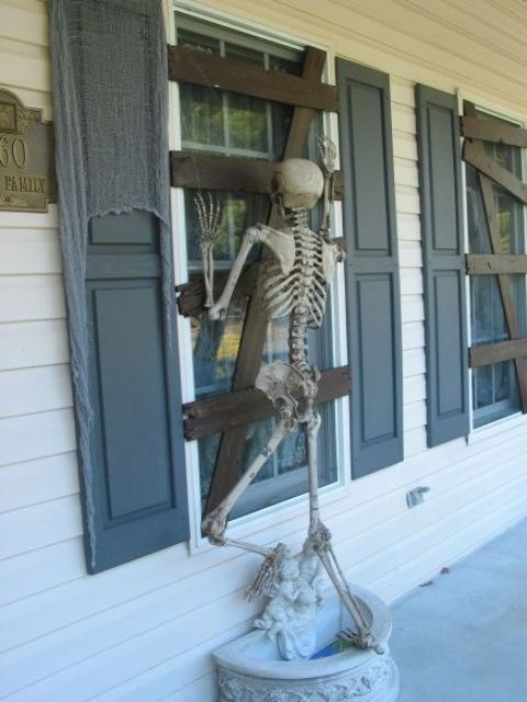 19-cardboard-affixed-to-window-to-make-it-look-boarded-up-and-skeleton-proped-to-look-like-its-trying-to-get-in