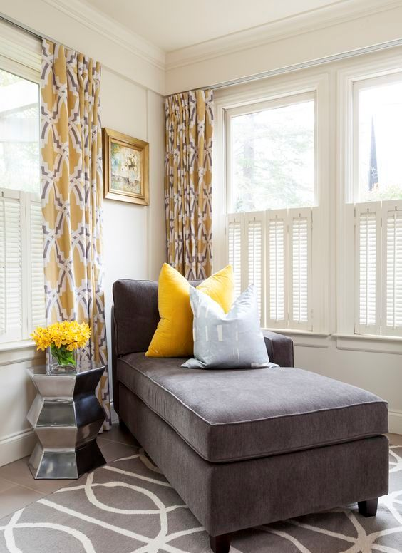 20-a-charcoal-couch-and-a-bold-yellow-pillow-look-very-contrasting