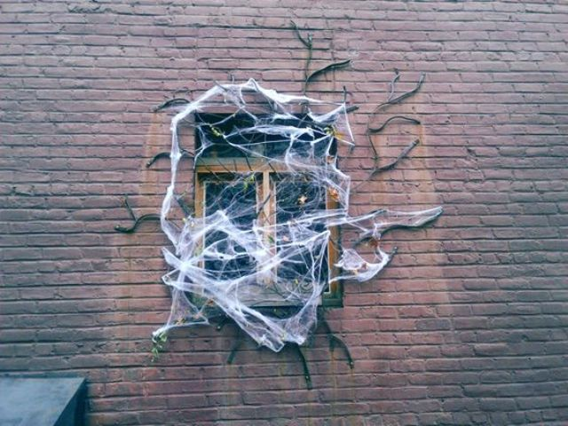 20-give-your-home-a-ghoulish-look-with-faux-spiderweb-branches-and-spiders