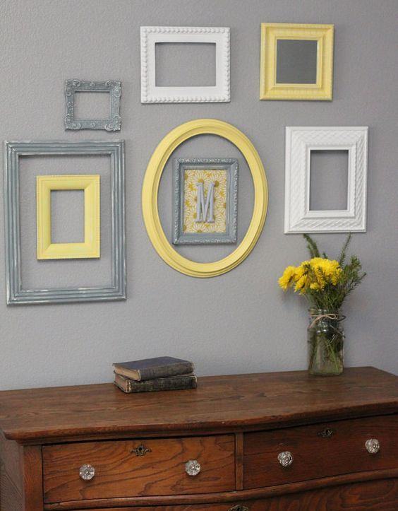 25-cream-grey-and-yellow-frames-on-a-light-grey-wall