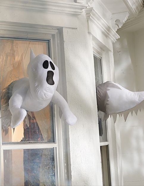 27-window-crasher-ghosts-that-appear-inside-and-outside-will-give-your-window-decor-a-new-dimension