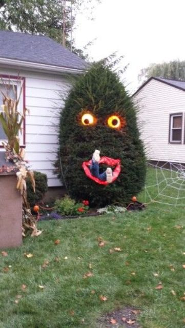 28-people-eating-Halloween-tree-with-lighted-eyes