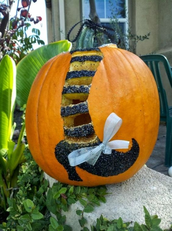 40-witch-leg-with-glitter-and-a-bow-on-a-pumpkin