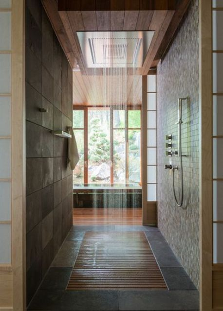 02-Japanese-styled-bathroom-in-dark-earthy-colors-with-a-rain-shower-and-wood-floor