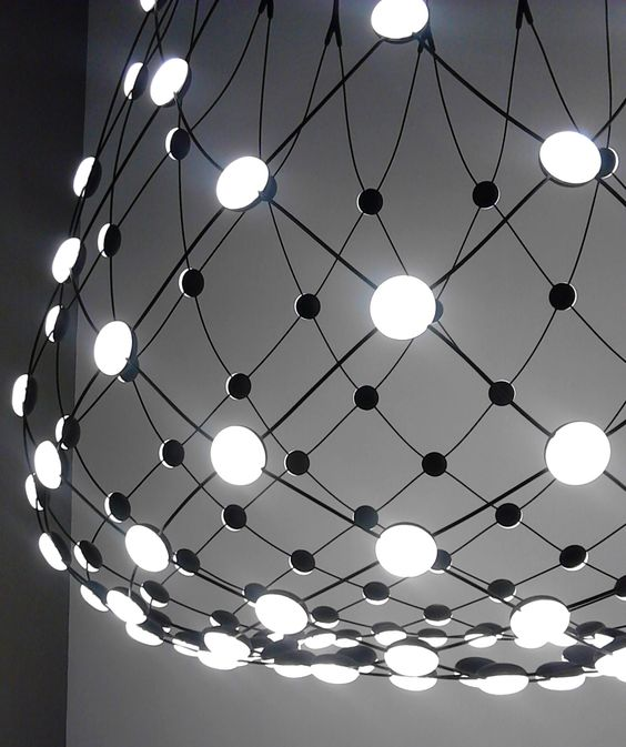 02-Mesh-has-unique-technological-aesthetic-there-are-metal-cables-with-LEDs-on-them