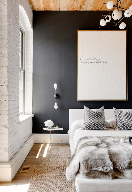 02-a-black-accent-wall-and-white-brick-create-a-beautiful-contrast