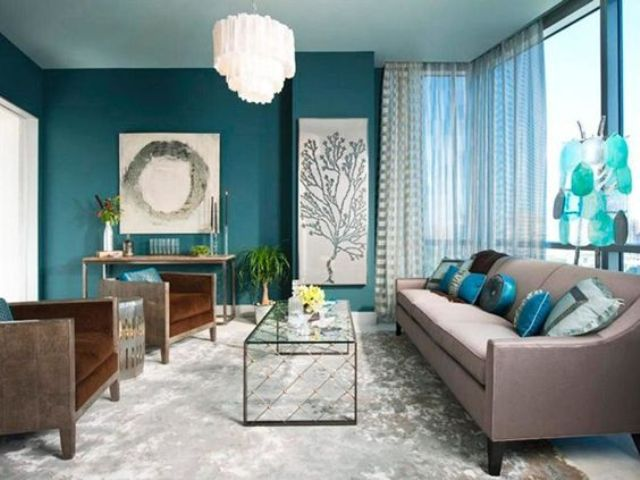 02-a-teal-accent-wall-aqua-blue-accessories-and-brown-upholstered-furniture