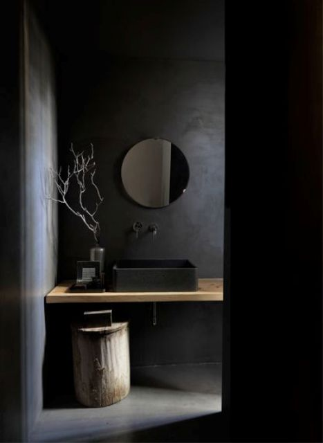 02-black-walls-a-black-sink-and-a-wooden-counter-and-stool-that-add-texture