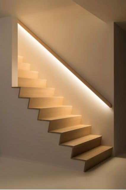 02-hidden-lights-in-the-banister-lights-up-the-staircase-so-the-owners-dont-need-any-lights-while-walking-up-or-down
