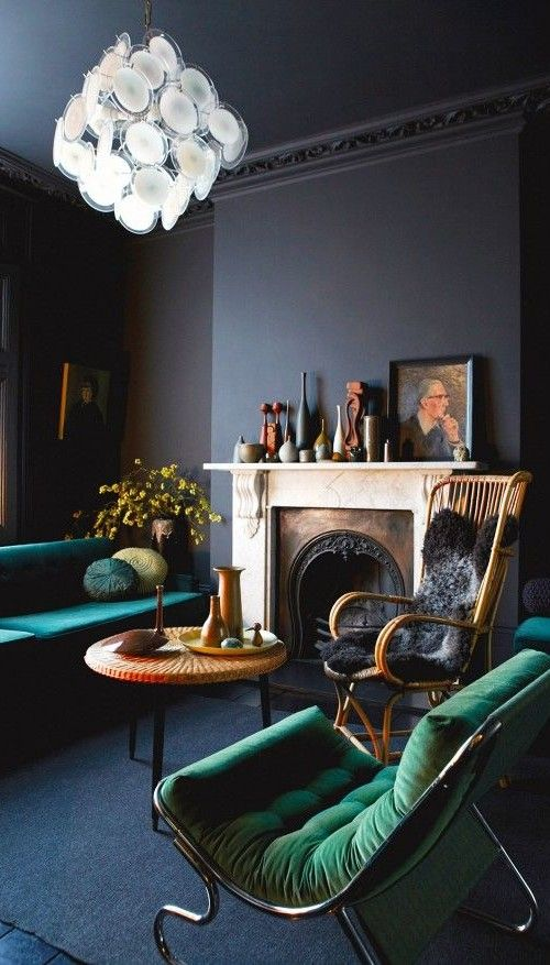 02-navy-and-black-living-room-with-emerald-furniture-and-an-antique-fireplace