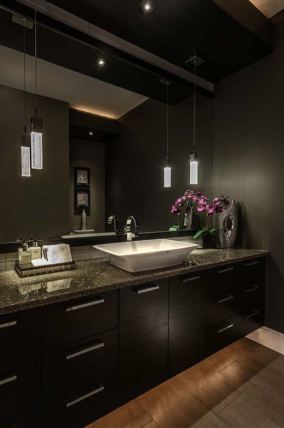 03-Asian-inspired-space-with-dark-cabinets-and-walls-and-chic-pendant-lamps