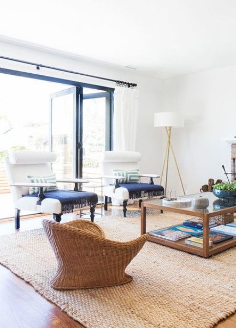 03-accentuate-a-neutral-room-with-a-jute-rug-and-wicker-furniture-with-navy-textiles