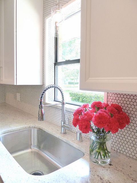 03-add-a-little-texture-to-your-backsplash-with-white-penny-tiles-and-grey-grout