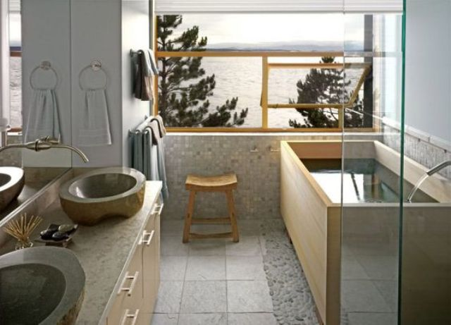 04-light-Japanese-bathroom-with-stone-sinks-a-wooden-bathtub-light-tiles-and-stone