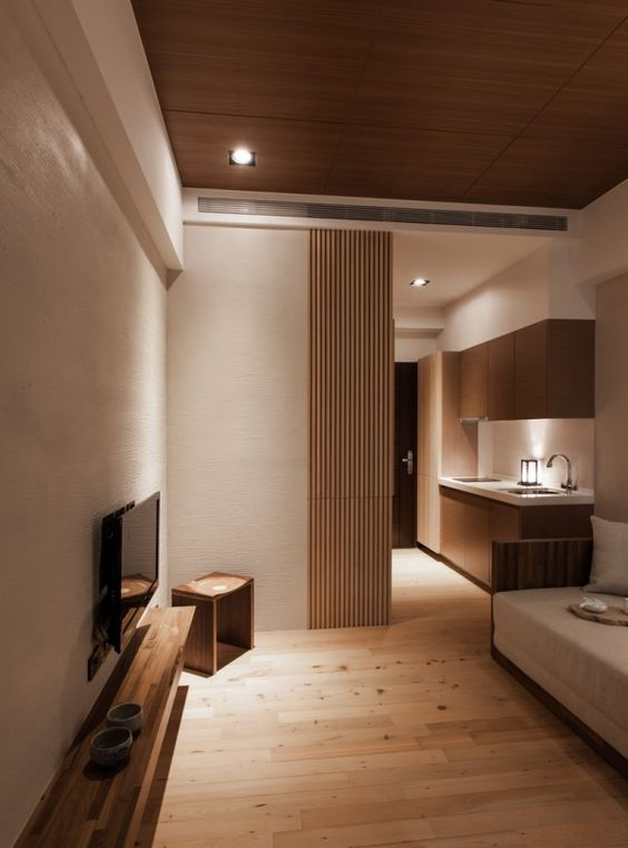 04-modern-small-living-room-with-an-extensive-use-of-light-wood-and-cream-walls