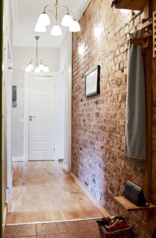 04-narrow-entryway-with-a-brick-wall-that-adds-texture