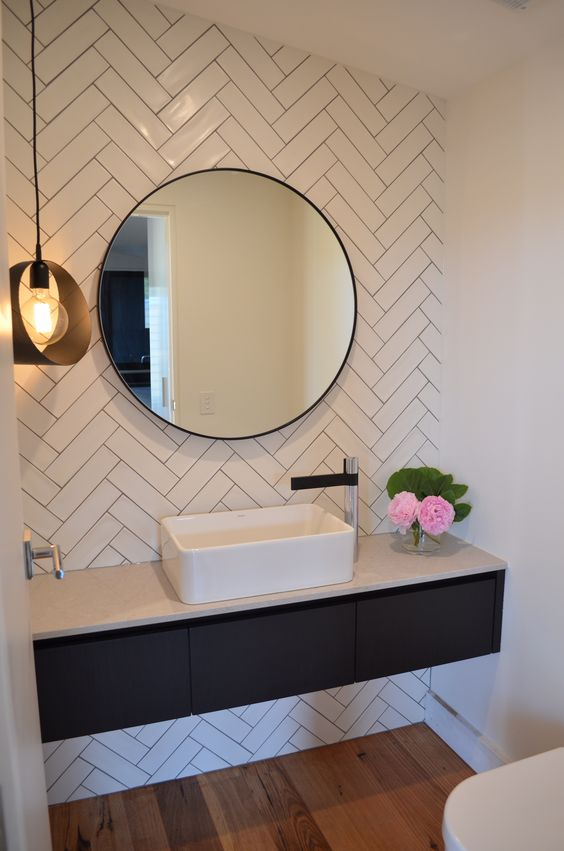 04-white-subway-tiles-clad-in-herringbone-pattern-in-the-bathroom
