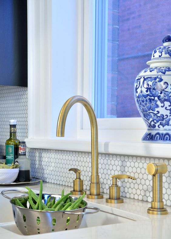 05-kitchen-with-white-penny-tiles-and-brass-faucets