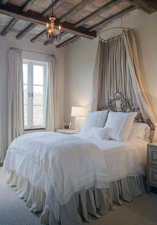 05-tihs-vintage-bedroom-has-just-a-candle-styled-chandelier-and-a-couple-of-lamps-by-the-bed