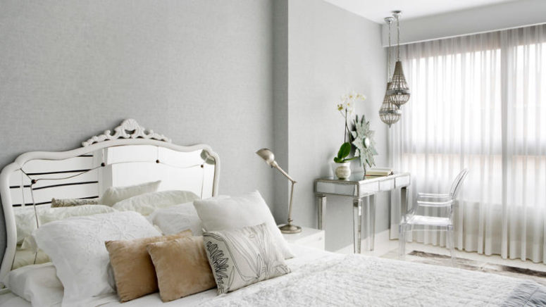 06-The-bedroom-is-glam-with-a-mirrored-bed-and-table-and-a-cool-lucite-chair-775x436