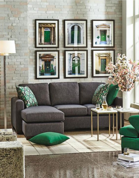 06-charcoal-grey-sofa-grey-stone-floors-and-emerald-and-gold-details-for-a-chic-and-sophisticated-look