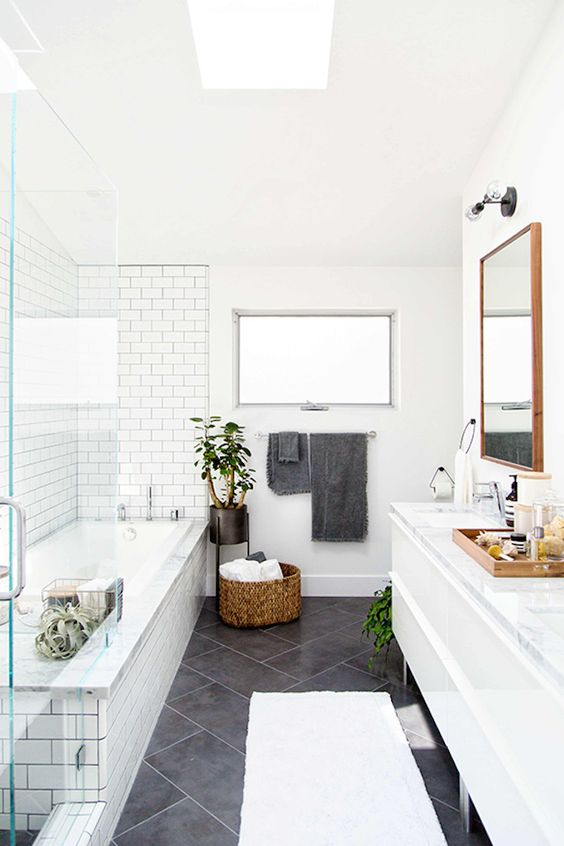 06-subway-tiles-accentuate-the-bathing-area-in-this-Scandinavian-bathroom