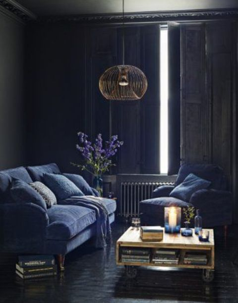 06-vintage-sitting-room-with-indigo-furniture-and-traditional-shutters