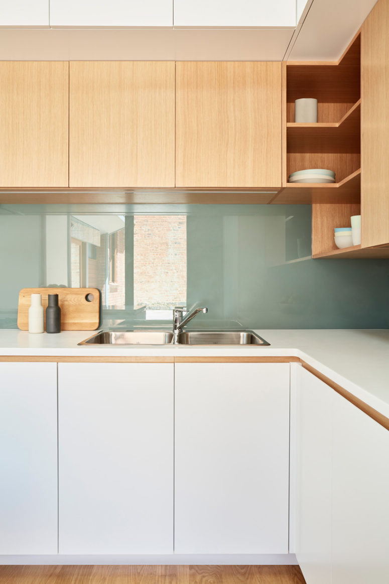 07-The-decor-is-modern-and-sustainable-with-a-sleek-look-warm-woods-and-glass-775x1163