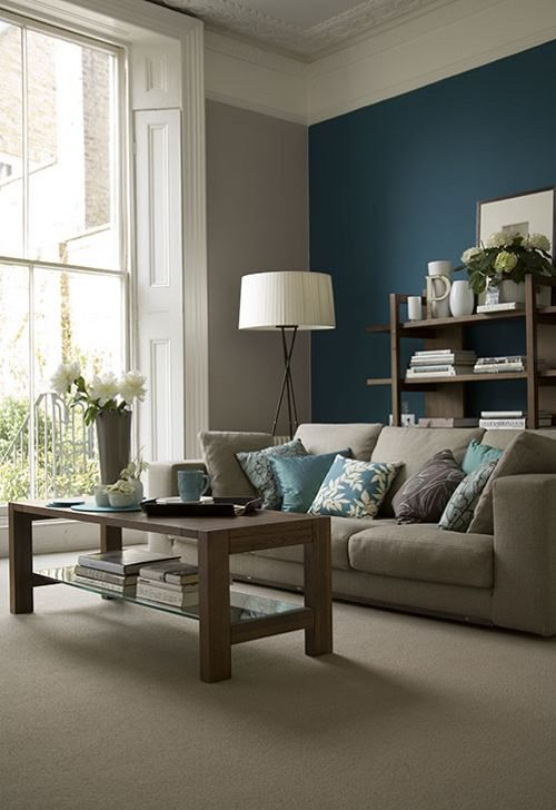 07-grey-and-beige-room-with-a-teal-accent-wall-blue-pillows-and-accessories