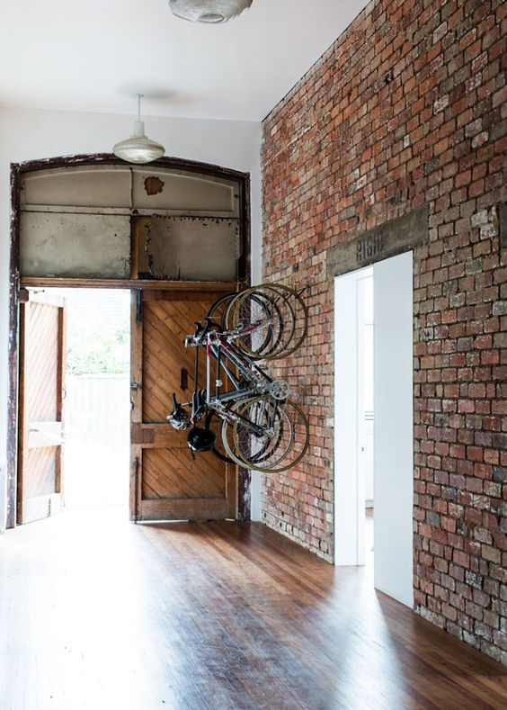 07-large-entryway-with-an-exposed-brick-wall-that-features-bike-holders