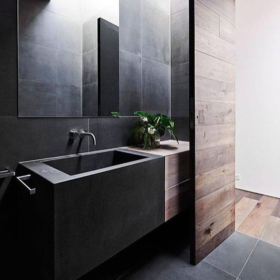 07-minimal-bathroom-space-in-black-that-is-softened-with-reclaimed-wood