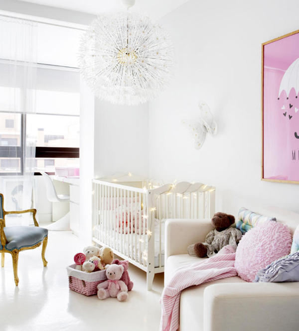 09-The-kids-room-is-done-in-white-and-pink-with-a-cute-lamp-and-a-couple-of-refined-touches