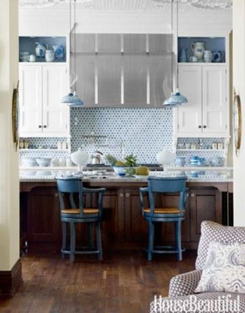 09-blue-penny-tile-and-delft-pottery-lend-a-watery-inluence-to-this-kitchen-with-white-cabinets-and-stainless-steel-hood
