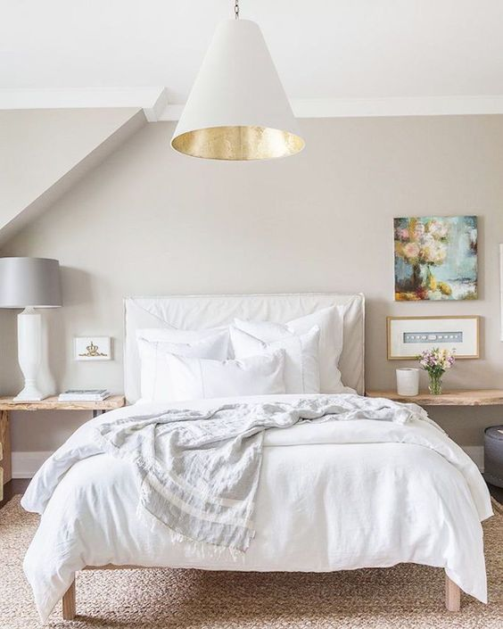 09-cozy-bed-with-neutral-bedding-and-pillows-looks-welcoming