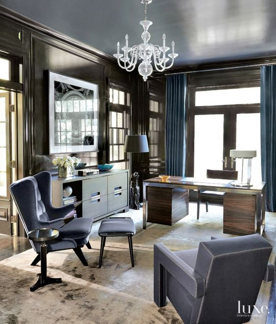 10-pairing-chocolate-paneling-and-cabinetry-with-lacquered-blue-shelving-and-a-reflective-blue-ceiling
