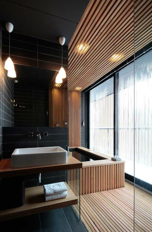 10-sensual-bathing-area-with-black-tiles-and-light-wood-slabs-that-keep-the-space-minimalist-yet-very-luxurious