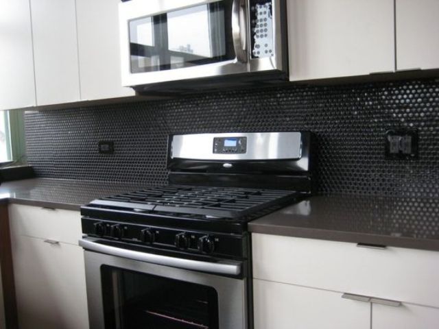11-glossy-black-penny-tiles-for-a-minimalist-black-and-white-kitchen