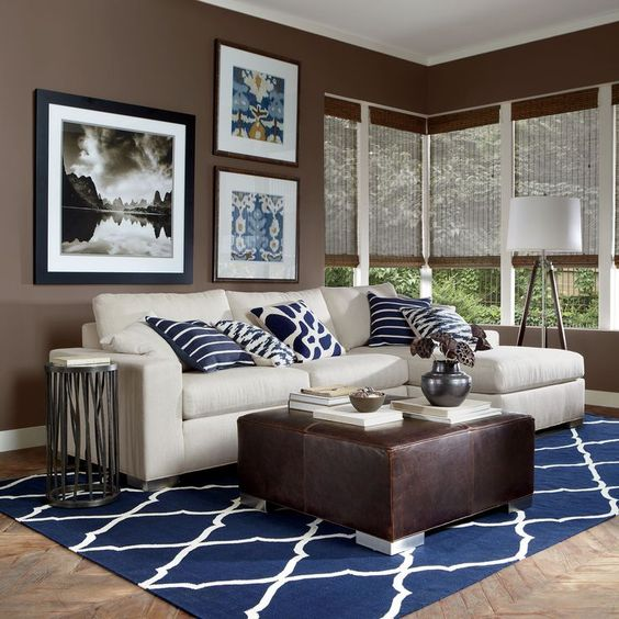 11-modern-brown-and-white-living-room-with-navy-pillows-and-a-carpet