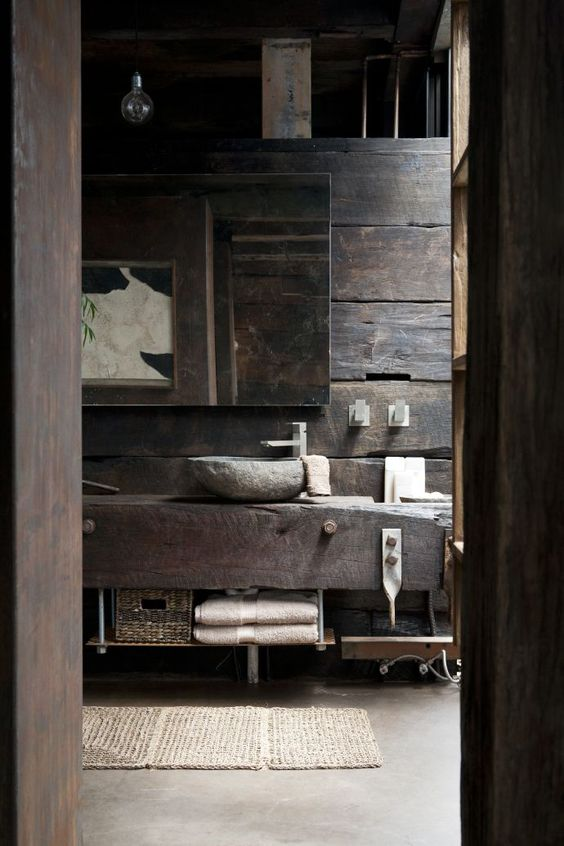 11-rustic-bathroom-with-rough-wood-and-stone-decor