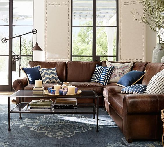 12-L-shaped-brown-leather-sofa-looks-great-and-refreshed-with-navy-and-blue-pillows