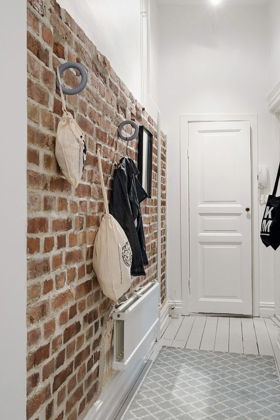 12-brick-walls-are-great-for-attaching-various-hooks-and-holders-so-its-a-functional-solution-for-an-entryway