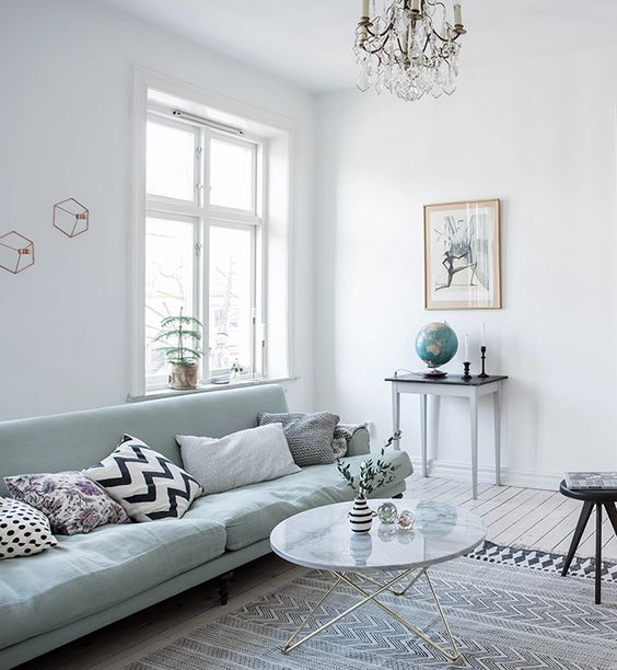 12-light-filled-room-with-a-mint-green-sofa