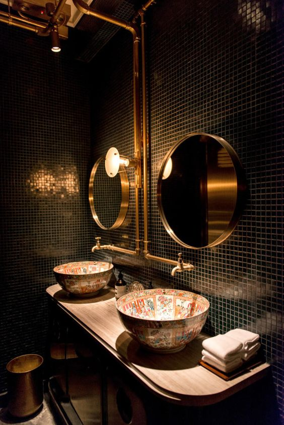 12-small-black-tiles-brass-details-and-unique-patterned-sinks